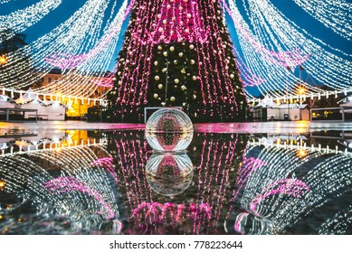 Christmas Tree through a glass ball in the Cathedral Square, Vilnius, Lithuania