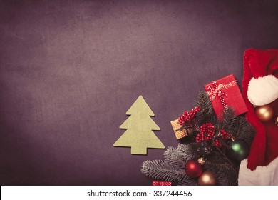 Christmas tree toy and gifts on grey background