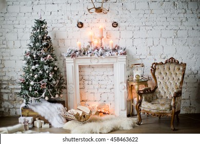 Christmas tree with vintage decorations near fireplace