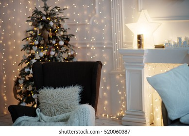 Christmas tree with vintage decorations near fireplace with lights