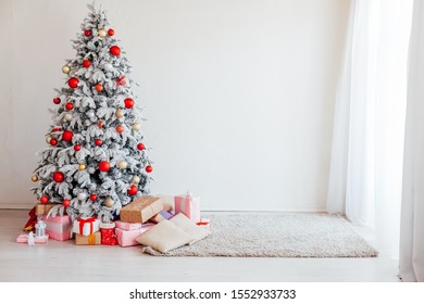 Christmas tree in the white room new year gifts