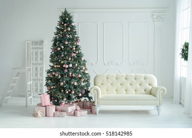 Christmas tree with a white sofa in a white room