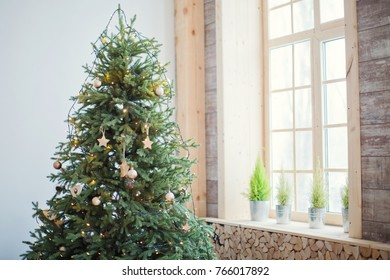 Christmas tree with wooden decorations and lights