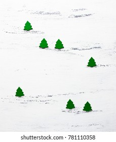 Christmas trees on wooden background