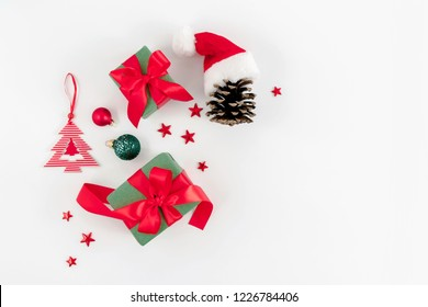 Christmas trendy composition. Xmas red and green decorations on white background. Christmas, New Year, winter concept. Flat lay, top view, copy space