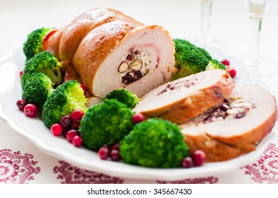 Christmas Turkey Breast Roll Stuffed with Cheese, Hazelnuts, Cranberries and Herbs, square