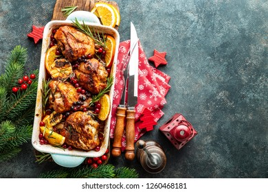 Christmas turkey legs baked with cranberries, orange and rosemary. Delicious festive dish for Christmas time. Top view,  christmas food background with space for a text