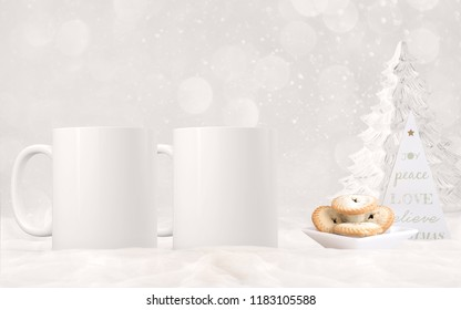 Christmas two mug mock-up. Two white blank coffee mugs to add custom design or quote. Perfect for businesses selling mugs, just overlay your quote or design on to the image.
