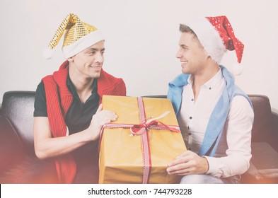 Christmas. Two sexy guys and gift.