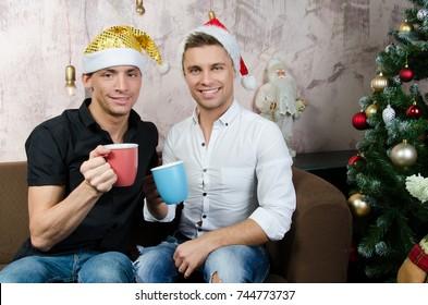 Christmas. Two sexy guys and and Christmas tree.