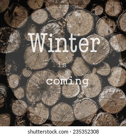 Christmas typography, handwriting Card with words Winter is coming over wood background. Merry Christmas lettering design