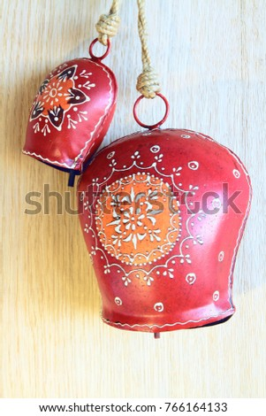Christmas Tyrolean red metal cowbells with hand drawn ornament on oak wood  background. - Christmas Tyrolean Red Metal Cowbells Hand Stock Photo (Edit Now