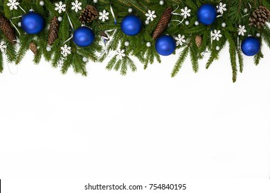 Christmas upper decoration with blue balls, stars  and cones  on white background.