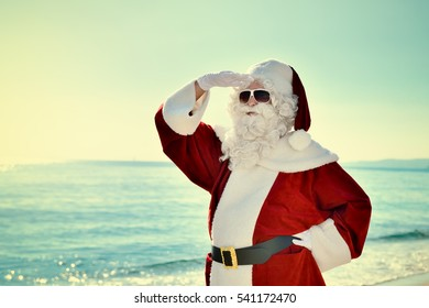 Christmas Vacation - Santa standing on the beach, looking for â?¦