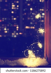 christmas vertical background, light garland with snowflakes in glass jar on window, magic sparks