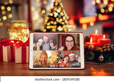 Christmas video call with the family. Concept of families in quarantine during Christmas because of the coronavirus. Xmas still life with a tablet in a cozy room
