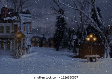 christmas village with bench and lantern