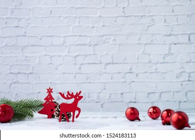 Christmas white background with decorations and papercraft reindeer on board.