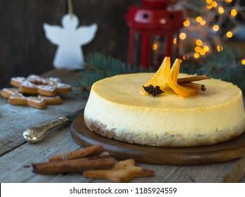 Christmas white orange  cheesecake with mascarpone. Festive Christmas food  traditional winter cake