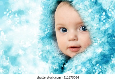 Christmas winter baby girl in a fur parka.