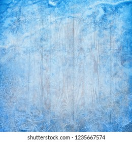 Christmas Winter Background with Ice Crystals and Wood Scrapbooking New Year design blue textured square backdrop template with frozen plank table and snow