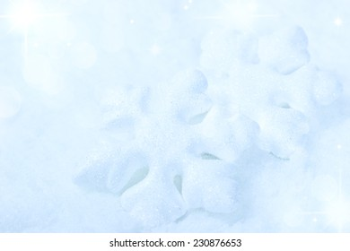 Christmas winter background with snowflakes in snow