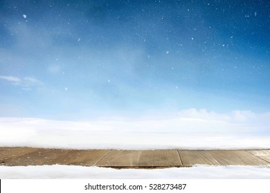 Christmas winter background and table of wood. Merry christmas greeting card with copy-space.