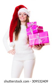 Christmas winter happiness concept. Woman in wearing santa helper hat holding stack of pink presents gift boxes isolated on white