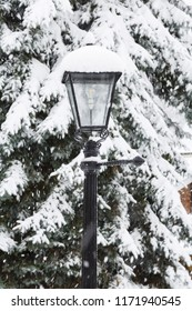 Christmas winter scene with a traditional cast iron Victorian lamp post covered in snow