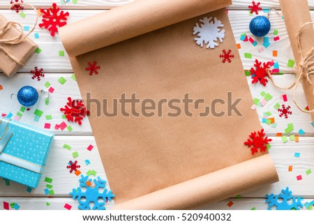 Christmas Wish List on the background of snowflakes and confetti close-up
