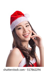 Christmas Woman. Beauty Asian Model Girl in Santa Hat isolated on White Background.