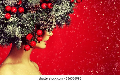 Christmas Woman. Fashion Girl with Decorated Hairstyle