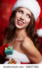 Christmas woman with gifts box .
