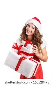Christmas woman holding presents excited. Young happy woman wearing santa hat looking to side showing Christmas gift isolated on white background. Beautiful young santa woman.