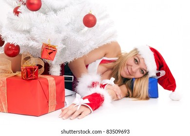 christmas woman lying on floor among gift