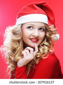 christmas woman over red background