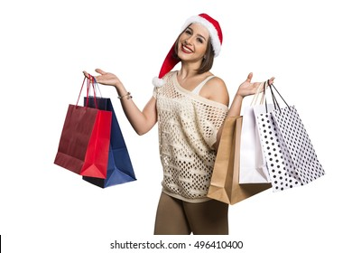 Christmas woman portrait holding christmas gift. Smiling happy girl in white background