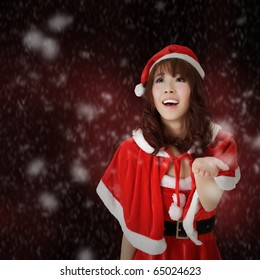 Christmas woman smiling and looking with snowflakes over red background.