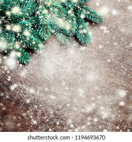 Christmas wooden background with fir tree, decoration and snow. Copy space. Flat lay.