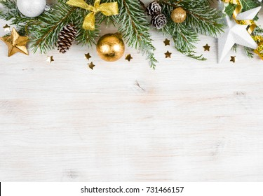 Christmas wooden background with frosted fir tree, view with copy space