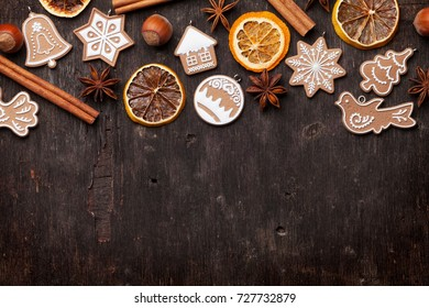 Christmas wooden background with gingerbread cookies. Top view with copy space for your greetings