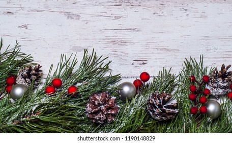 Christmas wooden background with pine tree, top view