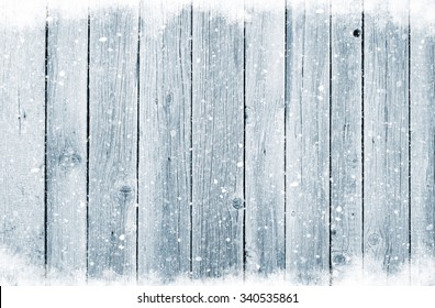 Christmas wooden background with snow