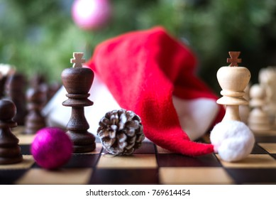Christmas wooden chess. Christmas tree and chess board with figures.