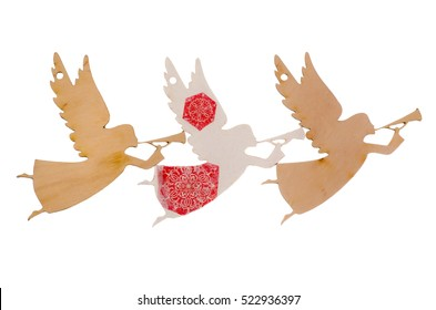 Christmas wooden figurines of angels on a white background