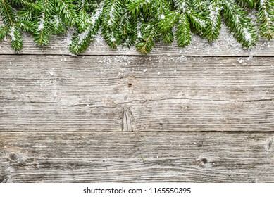Christmas wooden table with fir and snow, winter holiday decoration