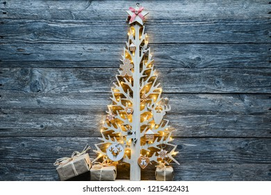 christmas wooden tree natural decoration ornament and copyspace on old wood board