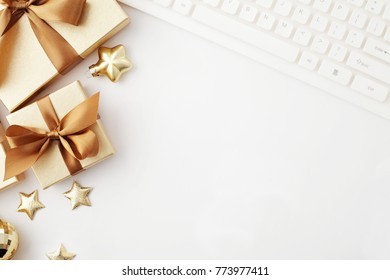 christmas workspace with notebook keyboard, christmas gifts and ornametns. copy space, flat lay