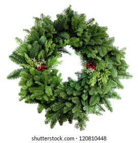Christmas wreath with assorted evergreen boughs on white