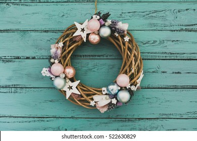 Christmas wreath with baubles on Blue Wooden Table. Copy space. Beautiful Christmas Background